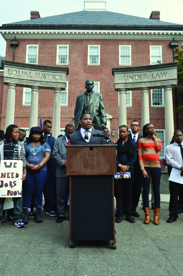 Dayvon+Love+speaks+to+a+crowd+protesting+a+new+youth+jail+in+Baltimore