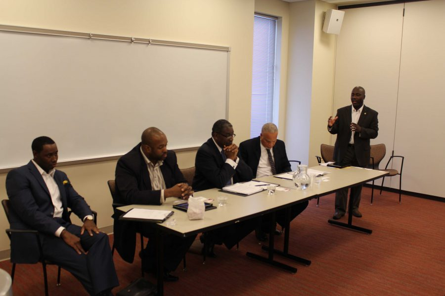 Panelists at the Black Men Matter Conference II argue for a credit history. (starting left to right Johnnie Fielding, Jerry Edwards, Arnold Williams, Calaway Braxton, Omar Mohammed) Photo credit: Soronia Taylor