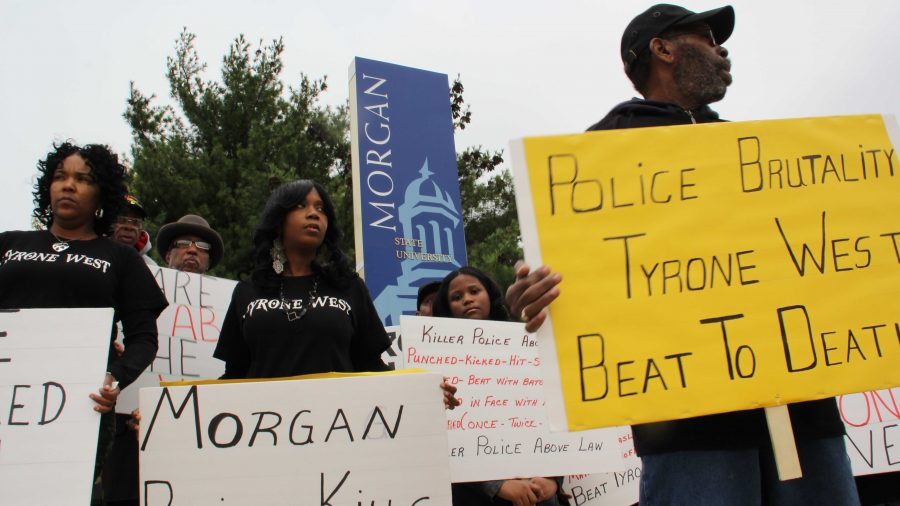 Relatives, friends and supporters protest Tyrone West's death outside Northeast District police headquarters on a recent