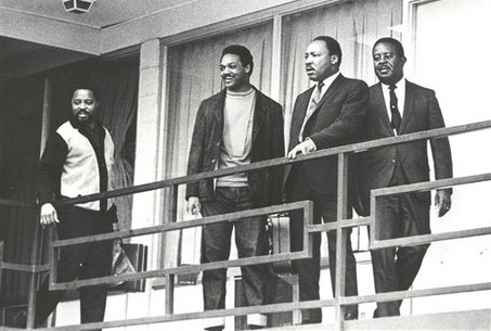 Martin Luther King, Hosea Williams, Jesse Jackson, Ralph Abernathy stand on the hotel balcony.