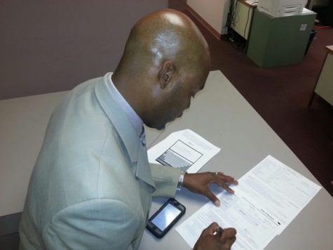 Russell Neverdon files official documents allowing him to be a write-in candidate for States Attorney on November 4, 2014
