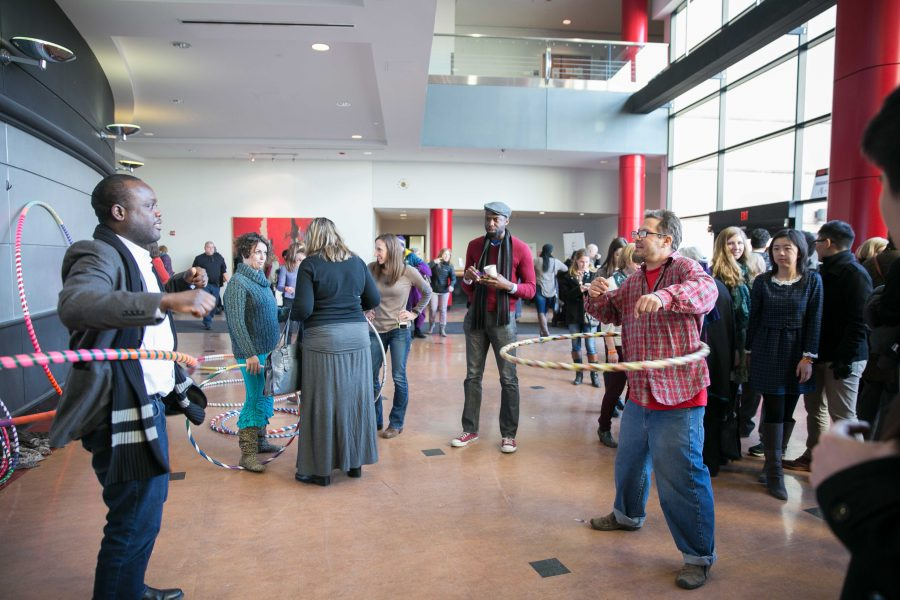 Andreas Spilly Spiliadis hula hooping with audience members during the afternoon break.