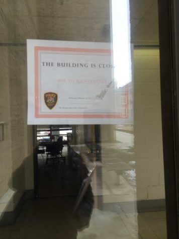 A sign on the building of the door.