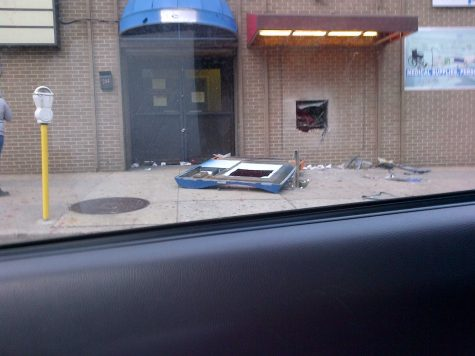 Rioters tore the ATM machine out of the wall.