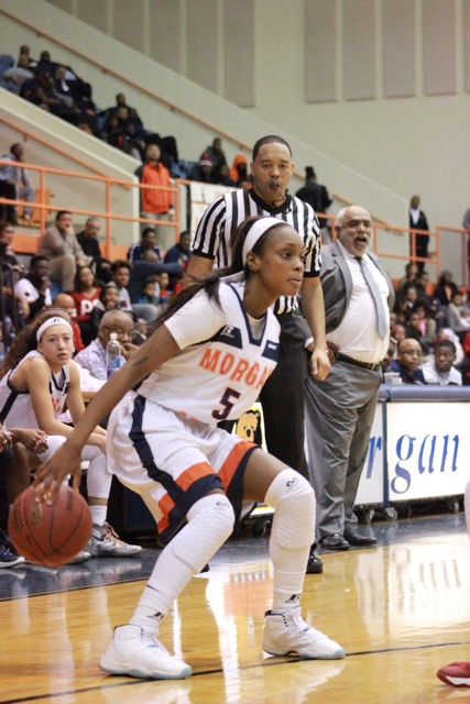 Sophomore guard Breannan Farrar sizes up her opponent.  Photo by Terry Wright