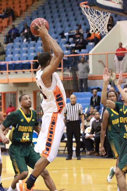 Junior Kyle Thomas goes up for a dunk against Norfolk State University on Wednesday. Photo by Terry Wright