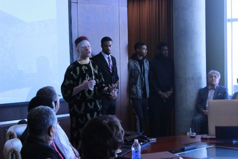Senior Chinedu Nwokeafor, flanked by members of S.M.O.O.T.H., addresses the Board of Regents regarding the murder of Morgan student Gerald Williams. Photo by Akira Kyles.