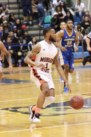 Senior Donte Pretlow brings the ball up the court against Coppin State on Monday night. Photo by Terry Wright.