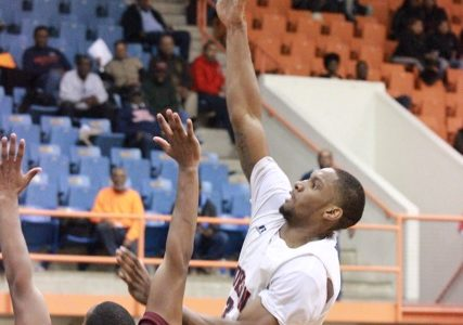 Senior Cedric Blossom puts up a layup against University of Maryland Eastern Shore. Photo by Terry Wright.