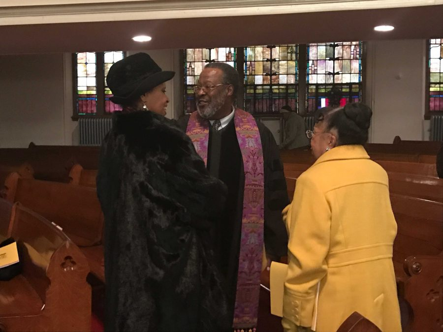 Reverend Bernard Keels, dean of the Morgan State University Chapel, with members of Sharp Street Methodist Episcopal Church. Photo by Benjamin McKnight III.
