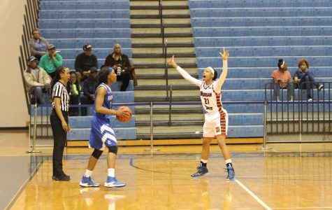 Senior guard Ivy Harrington playing defense against the Hampton Lady Pirates on Saturday. Photo by Wyman Jones.