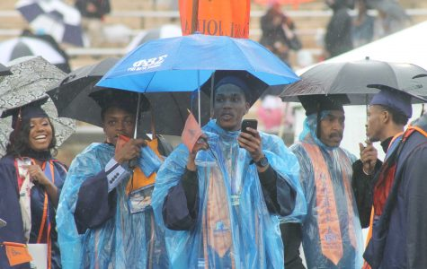 Rain, mist don't dampen commencement spirits