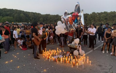 Manuel Luis' family and friends gather for a candlelight vigil in his honor.