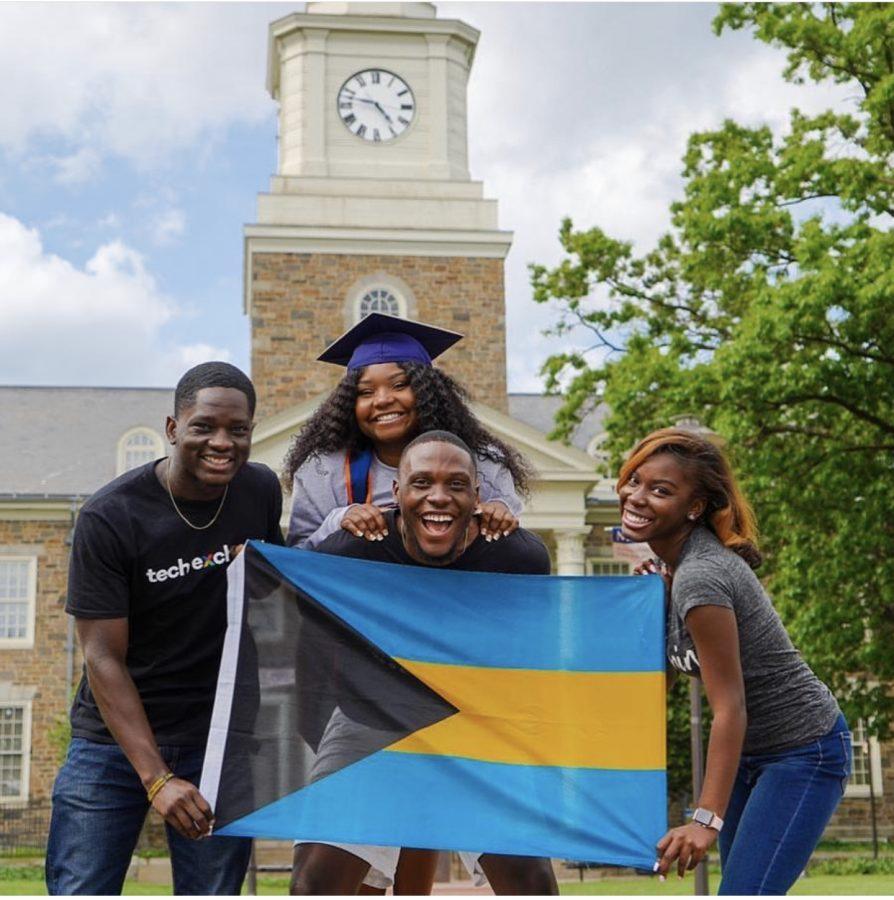 From left, Michael McDonald, Valecia Hannah, Jeffon Stubbs and Jamielle Davis hold up the national flag of the Bahamas.