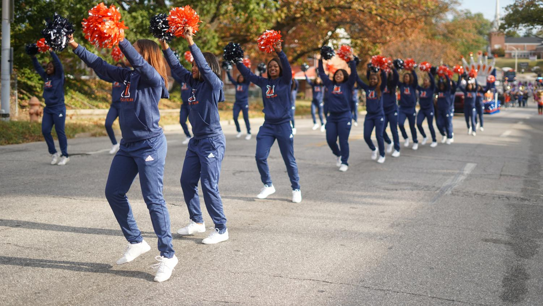 Morgan's cheerleaders perform during the Homecoming parade.