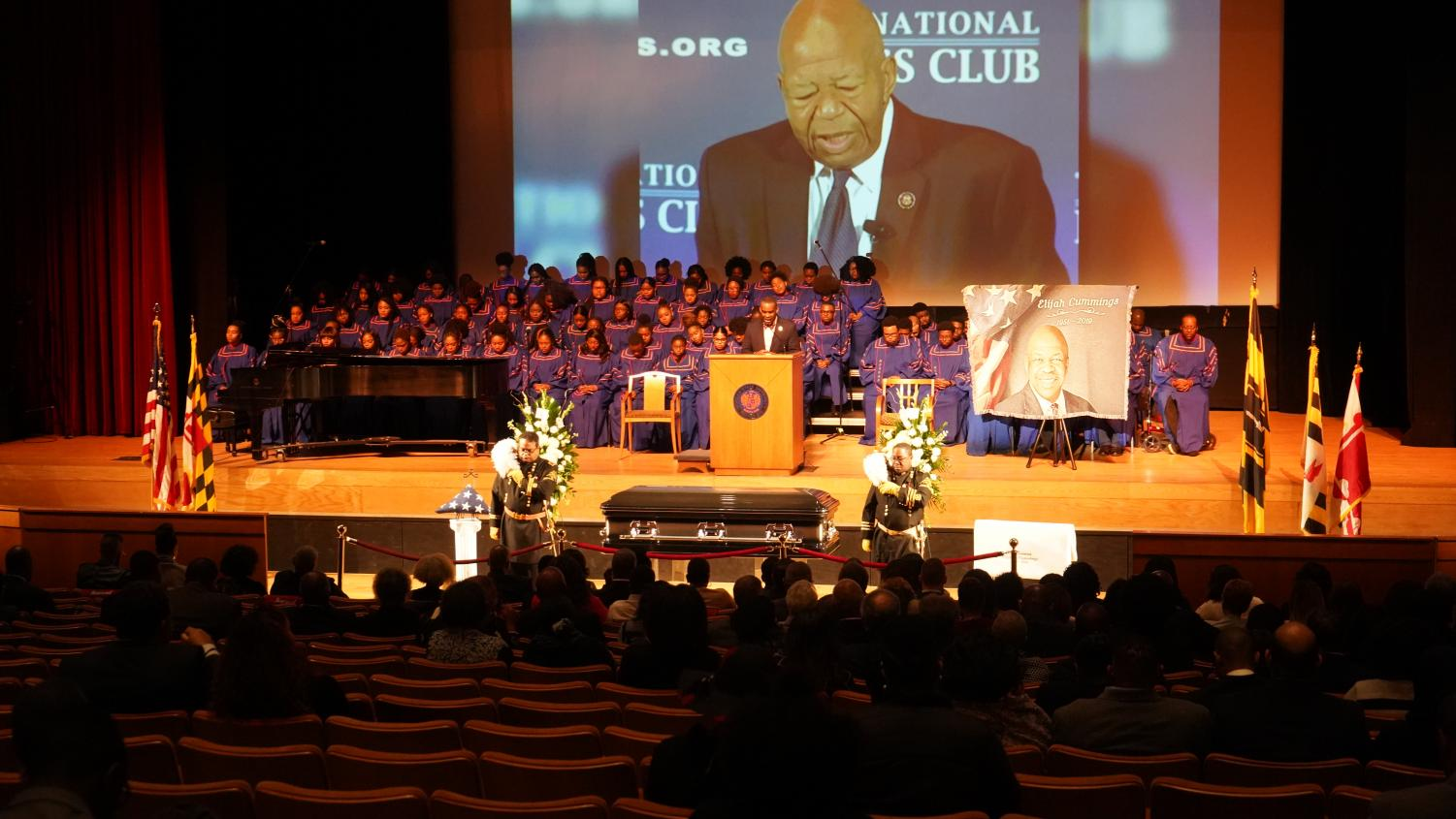 Rep. Elijah Cummings' casket was flanked with flowers and guards as the university choir sat on stage and a slideshow in Cummings' honor played.