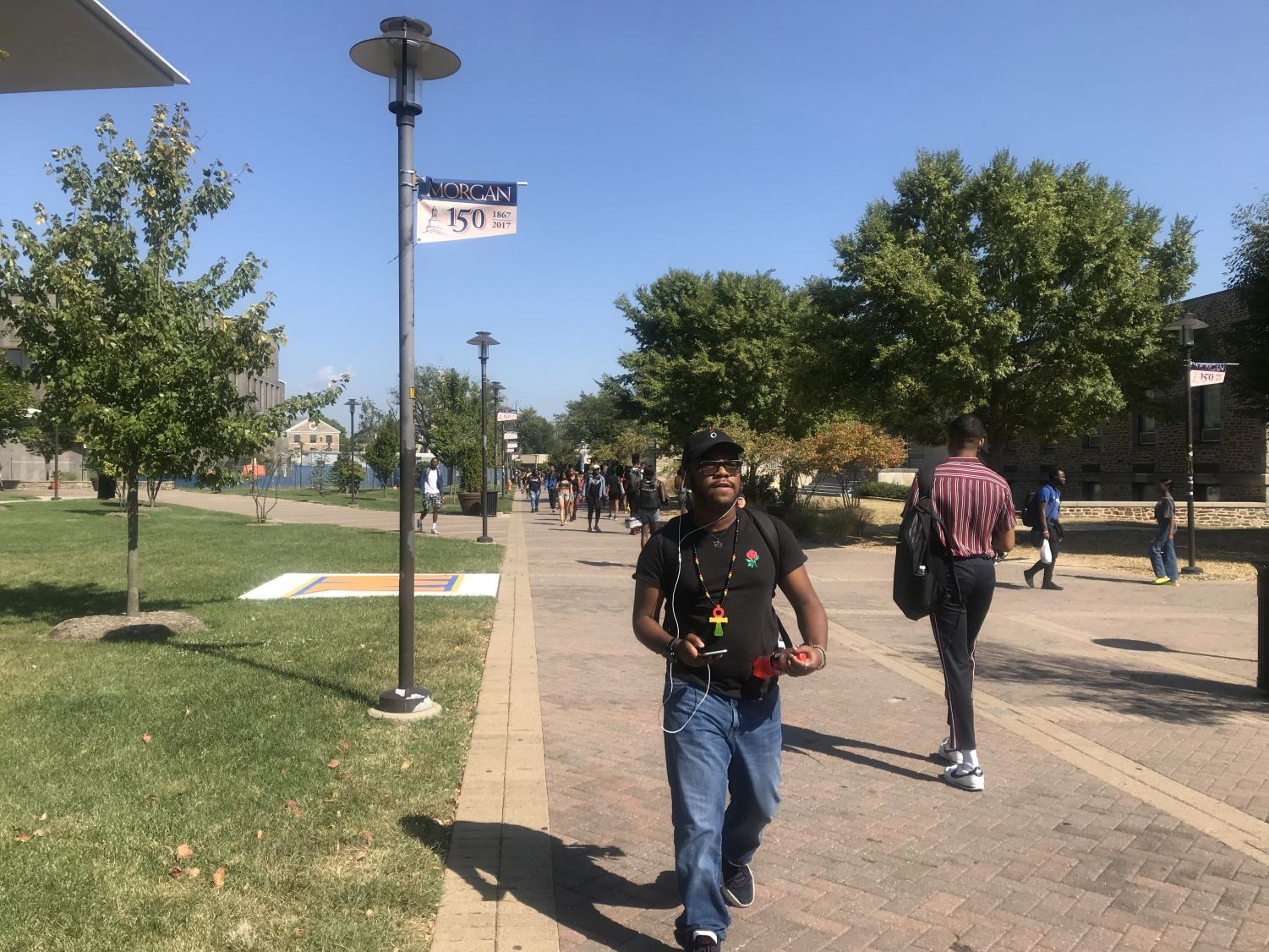 Morgan students walk between the library and the Student Center.