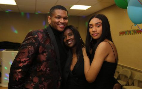 Brianna (right) poses with her mother Trina Murray (middle) and brother Shane Taylor (left) at her grandmother's 80th birthday party.