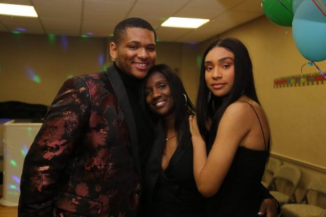 Brianna (right) poses with her mother Trina Murray (middle) and brother Shane Taylor (left) at her grandmother