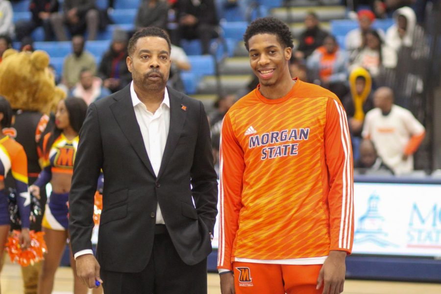 Stanley Davis Jr. (right) poses with head coach Kevin Broadus (left) after scoring 1,000 career points.
