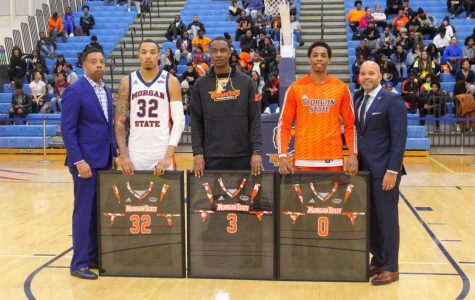 Senior forwards David Syfax Jr., Victor Curry and Stanley Davis Jr., accepts personalized Jerseys at Thursday's game.