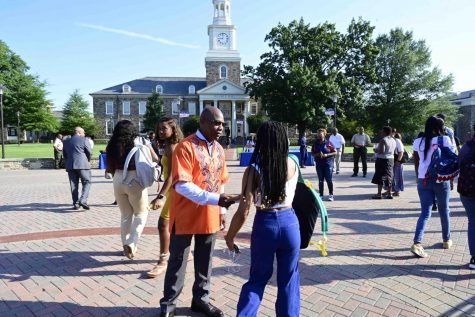University President David Wilson greets students on the first day of the fall semester 2019.