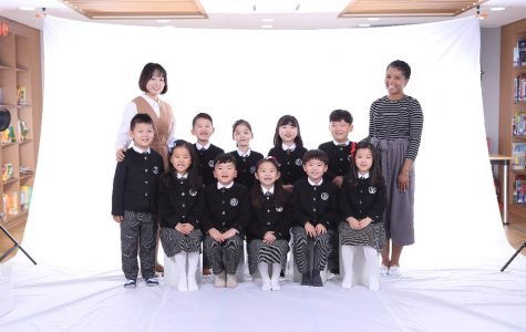 Morgan alum Janelle Ferguson (r) with her class of English-as-second language students in South Korea