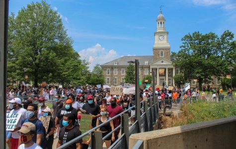 Hundreds of protesters gather by Holmes Hall to begin their march.