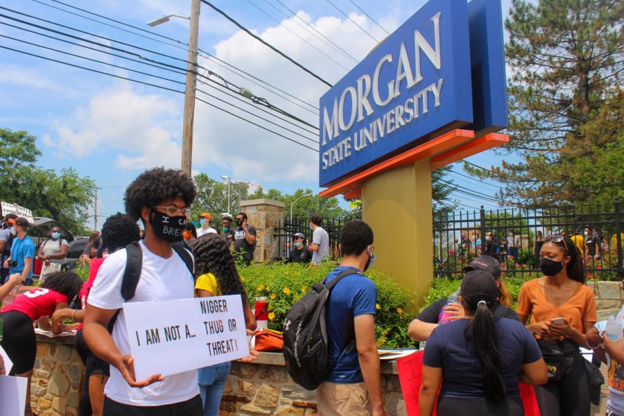 Protestors+gathered+by+the+Morgan+State+University+sign+prior+to+the+march.