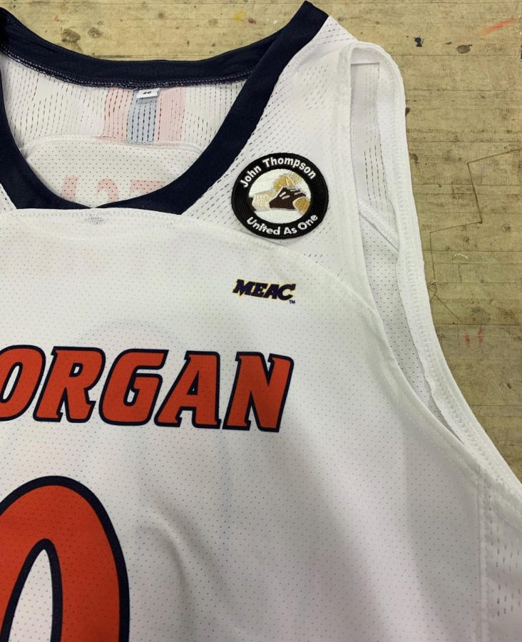 Morgan State's men's basketball jersey, which features a patch honoring the late John Thompson Jr., is located on the left shoulder of the jersey.