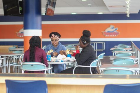 The day after the cancellation of in person classes for the remainder of the March 9-13 week, the Student Center canteen was empty during their busiest hour, only occupied by Joy Akinkuade, Jennifer and Jacqueline Mugerwa.