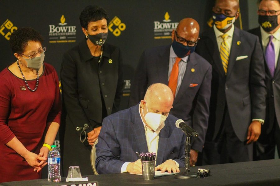 Gov. Hogan signs the bill surrounded by University of Maryland Eastern Shore President Heidi Anderson, Bowie State University President Aminta Breaux, Morgan State University President David Wilson, and Coppin State University President Anthony Jenkins.