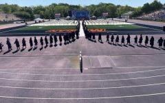 Prospective graduates march into Hughes Stadium