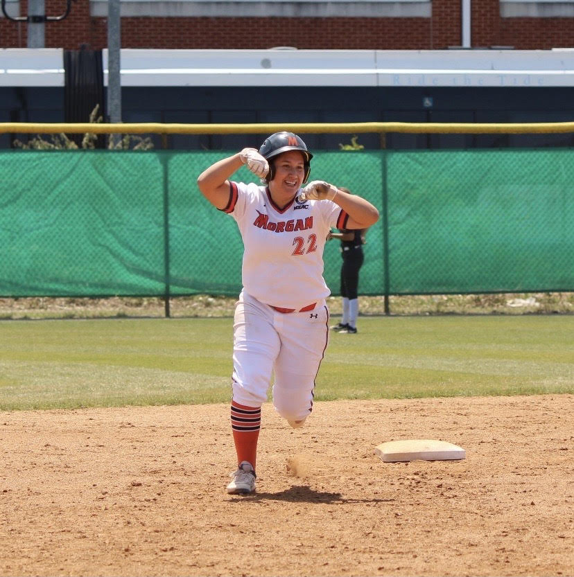 Sophomore Melissa Paz hits a three-run, 3rd inning homer to give Morgan a lead