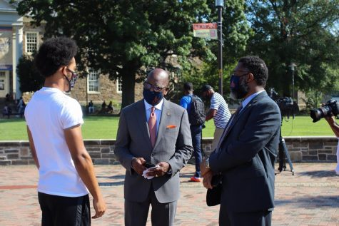 President David Wilson greeted students on their way to classes.