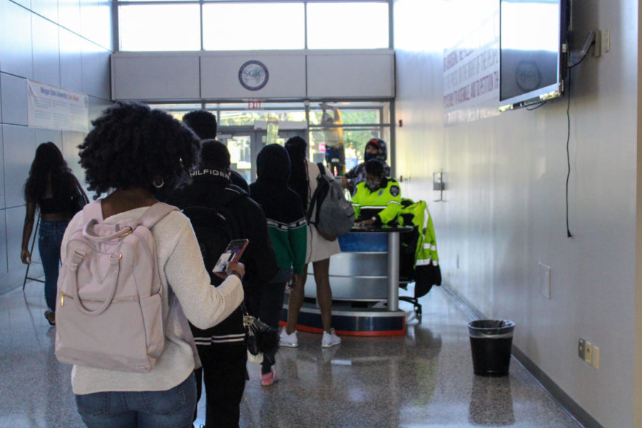 Students stand in long lines as they wait for the daily COVID-19 screening questions.