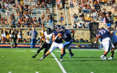Neil Bourdeau in his first game as starting quarterback against Towson University.