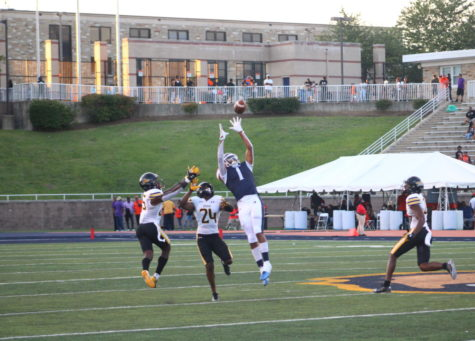 Wide receiver Thomas Marcus makes the catch against Towson last Saturday.