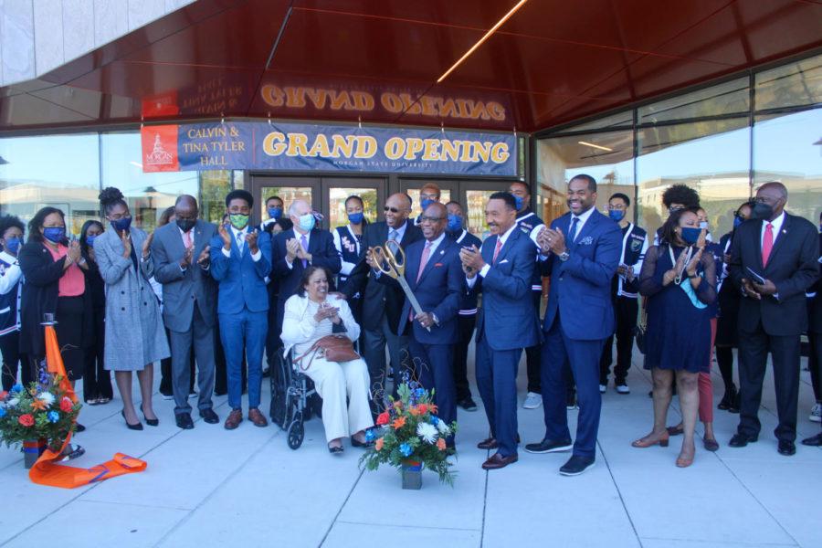 Mayor Brandon Scott, Governor Larry Hogan, President David Wilson, Calvin and Tina Tyler, Congressman Kweisi Mfume and more cheer for the grand opening of Tyler Hall.